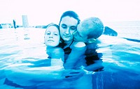 Three teens in swimming pool