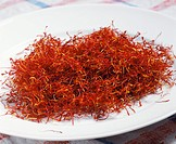 Saffron. Harvested stigmas from saffron flowers  (Crocus sativa). The bright red stigmas are part  of the female reproductive structure of the  flower...