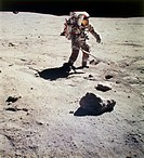Apollo 16 photograph of Commander John W. Young collecting samples at a North Ray crater geological site. The Apollo 16 mission was launched on 16 Apr...