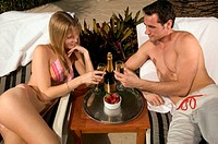 Couple toasting on honeymoon