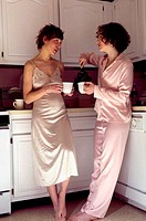 Women drinking tea in kitchen