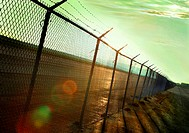 FV6066, Jean Desy, Barbed Wire Fence at Sunset