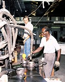 Men working at Nazeing Glassworks in Broxbourne, Hertfordshire. Established in 1928, the works mainly produces industrial glass with some ornamental g...