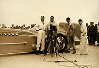 Photograph showing Campbell (1885-1949) and his Rolls-Royce powered racing car the ´Bluebird´ at Daytona Beach racetrack, Florida. Campbell was the ho...
