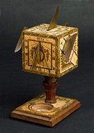Cubical polyhedral sundial in wood with paper scales, signed D Beringer. Sundials were accurate enough timekeepers for most people in the 18th century...