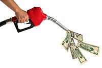 A womanøs hand holds a red gas pump pouring out American dollar bills.