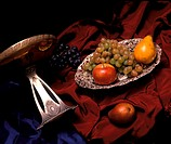 Fruits and Silverware on a Red Drapery