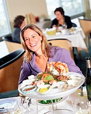 happy woman at seafood restaurant
