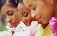 African American Women Smelling Flowers