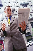 executive reading newspaper