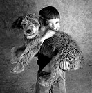 child hugging shaggy dog