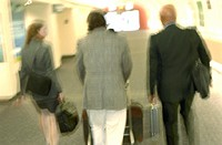 Businesspeople Walking Through Terminal - Blurred