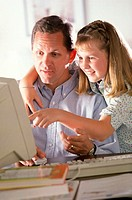 Father and Daughter On Computer