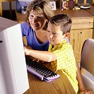 Mother Helping Son On Computer