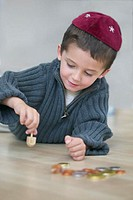 Jewish boy with dreidel