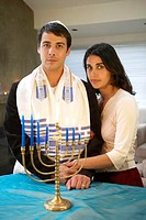 Jewish couple with Menorah