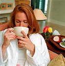 redhead drinking a cup of herb tea
