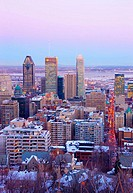 View of downtown Montreal skyline and South Shore from atop Mount Royal (Mont Royal) in winter during sunset. Quebec, Canada