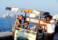 Man selling drinks by waterfront. Havana. Cuba