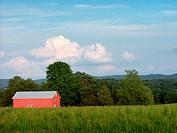 Barn in field sits under a summer sky in Hunterdon County. New Jersey, USA