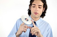 A businessman spinning a CD on his finger