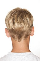 Portrait view of the back of a young blond- boys head