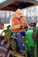 Portrait of farmer sitting on a tractor