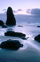 Twilight over the Pacific Ocean and sea stacks at the beach below Cape Meares. Tillamook County. Oregon. USA