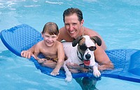 father/son with funny dog in the pool