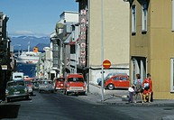 Looking down a street in downtown Reykjav&#195;&#173;k, a cruise ship in the background