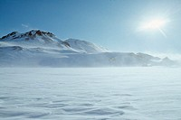 Iceland - Sun shining over a snow covered mountain