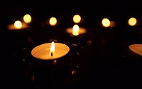 Candles burning in darkness
