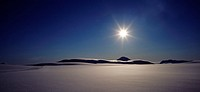 Iceland - Sun shining over a snow covered landscape