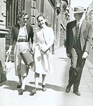 Robert Oppenheimer and his girls walking on the sidewalk