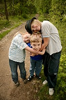 A group of 3 young boys  ( 9,10,13 years )