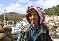 Worker at the olive oil factory. Jerash, Jordan