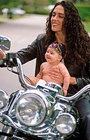 Mother and baby on motorbike