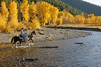 Couple horseback riding near Sun Valley, Idaho. USA