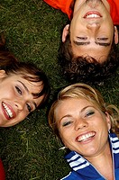 Three teenager lying on the gras, portrait (thumbnail)