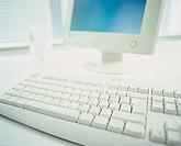 Close-up of a Computer Keyboard and Monitor