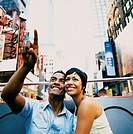 Young Sightseeing Couple Travelling on an Open Top Bus in New York City