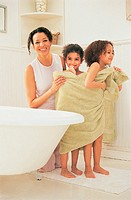 Mother in a Bathroom Drying Her Daughters With a Towel