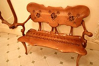 Wooden bench in the Apartment, recreation of a bourgeois apartment in the beginning of 20th century at Milà House (aka La Pedrera 1906-1912 by Gaudí);...
