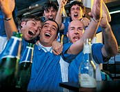 Group of Football Fans in a Pub Celebrating