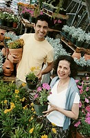A Mother and Son in a Gardening Shop Holding Potted Plants