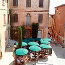 Roussillon village square and café terrace. Vaucluse, Provence. France.