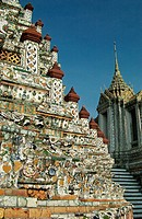 Close up on the tower plated with mosaic of porcelain pieces. Wat Arun temple (Temple of the Dawn). Bangkok. Thailand