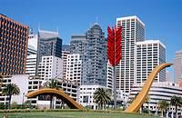 Sculpture Cupid Span and skyline. Esplanade by Embarcadero. San Francisco, California. USA