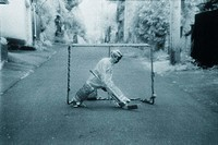 Boy playing road hockey