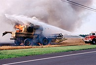Combine and wheat field fire